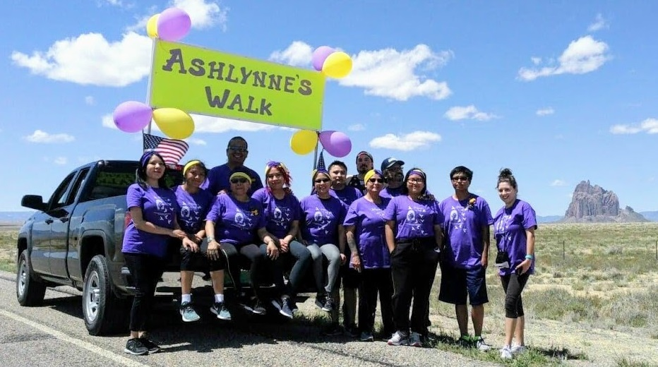 Participants standing together outside near Shiprock, New Mexico, to participate in a memorial run/walk in honor of Ashlynne Mike